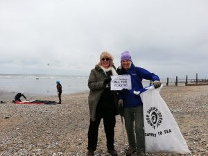Maureen and Rosie litter picking on the beach